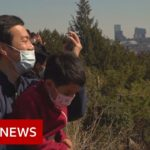 Coronavirus: People in Beijing begin to head outdoors   BBC News