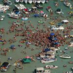 Huge sandbar party on Fourth of July may have spread COVID 19, Michigan officials say