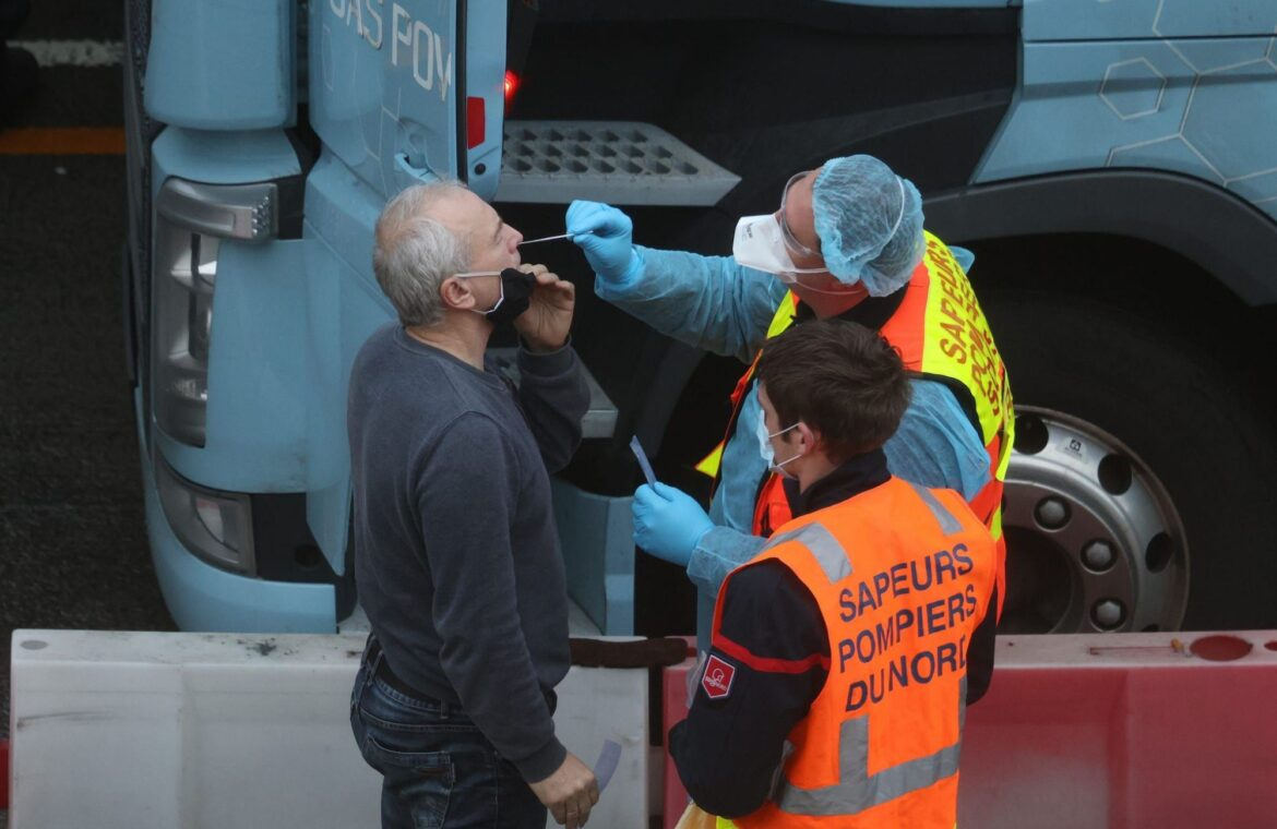 Britain is sending 800 military personnel to its border with France as it tries to break the logjam of truck drivers stranded by COVID 19 restrictions