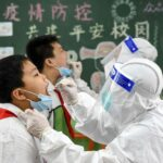 Strict lockdowns, experimental vaccine helped China recover from COVID 19