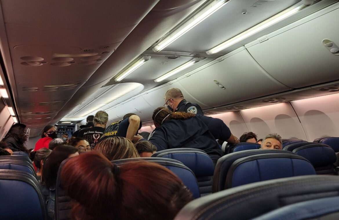 EMT who gave CPR to passenger with COVID 19 says he has symptoms
